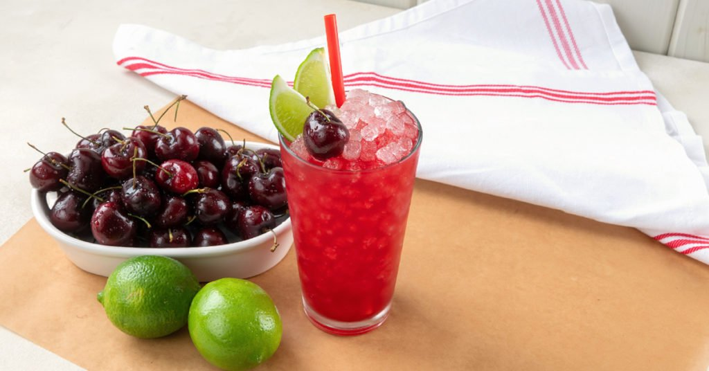 glass of sonic cherry limeade made from copycat recipe on a table